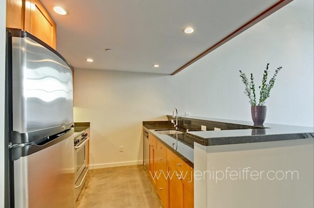 1325 Indiana St Unit 208_Beautiful Kitchen includes s/s appliances, granite countertops, maple cabinetry. Courtesy Jeni Pfeiffer
