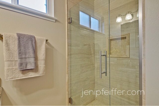 Luxurious Walk-In Shower features Travertine Tile. Photo Courtesy Jeni Pfeiffer