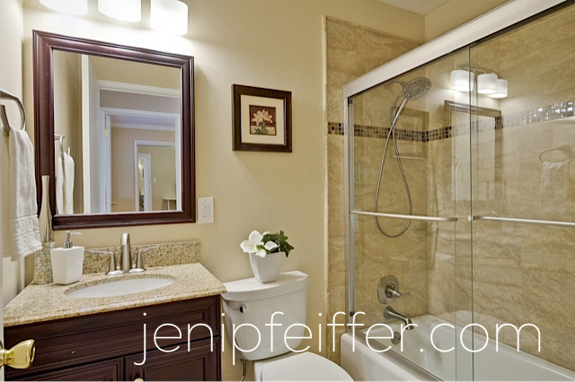 Luxurious Bathrooms with Granite and Tile Surround. Photo Courtesy Jeni Pfeiffer