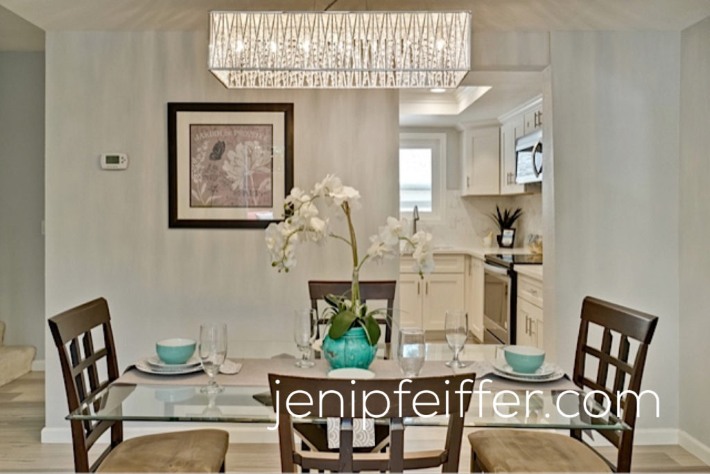 Large Dining Room with Beautiful Chandelier_Photo Courtesy Jeni Pfeiffer